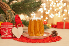 Christmas. Cake, candle and pine cone Stock Photography