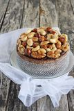 Christmas cake with caramelized nuts,chocolate and spices. Stock Photography