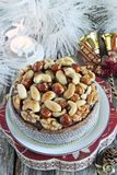 Christmas cake with caramelized nuts,chocolate and spices. Stock Image