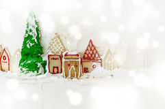 Christmas cake. Decorated by ginger bread and icing sugar in winter theme with snow effect Royalty Free Stock Images