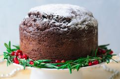 Christmas Cake Decorated with Icing Sugar, Rosemary and Pomegranate stock photography