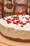 Christmas cake decorated with pomegranate grains and snowflakes of fondant Royalty Free Stock Photo