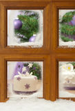 Christmas Cake In Frosty Window Stock Image