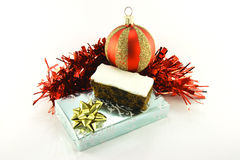 Christmas Cake with Gift, Bauble and Tinsel Stock Photos