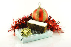 Christmas Cake with Gift, Bauble and Tinsel Stock Image