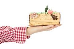 Christmas cake on hand Royalty Free Stock Image