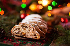 Christmas Cake and Holiday Decorations. Traditional German Stollen with Berries,Nuts, Marzipan. Stock Photos