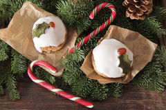 Christmas cake with homemade caramel cane. On the background of trees stock image