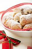 Christmas cake with icing sugar in a bowl Stock Images
