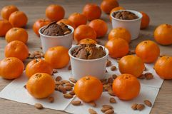 Christmas cake with mandarins. Chrismtas cakes on the table surrounded with mandarins and almonds royalty free stock photos