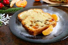 Christmas cake with nuts, dried fruit, tangerines. stock images