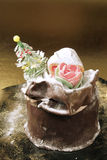 Christmas cake (Panettone). Chocolate panettone, an italian christmas dessert. It is decorated with a tree and a rose on the top royalty free stock photography