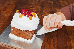 Christmas cake pastry bag decoration Stock Image