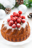 Christmas cake on a plate and decorations, close-up, top view Royalty Free Stock Image