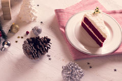 Christmas cake on plate on red fabric on wood background and dec Royalty Free Stock Photography