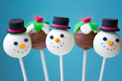 Christmas cake pops. Snowman and Christmas pudding cake pops Stock Images