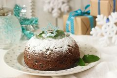Christmas cake or pudding in festive decoration. Royalty Free Stock Images