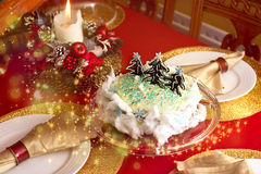 Christmas cake. On a red and gold table setting Royalty Free Stock Image