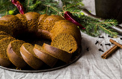 Christmas cake from rye flour with honey and spices. Cake from rye flour with honey and spices, surrounded by fir branches with chilli Royalty Free Stock Image
