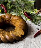 Christmas cake from rye flour with honey and spices. Cake from rye flour with honey and spices, surrounded by fir branches with chilli Stock Photos