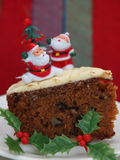 Christmas Cake with Santas. Santas on a Christmas carrot cake Royalty Free Stock Image