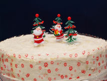 Christmas Cake with Santas. Santas on a Christmas cake Stock Photos