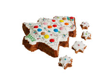 Christmas cake in a shape of a christmas tree and small biscuits Stock Photography