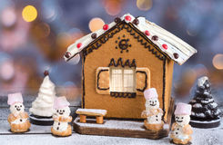 Christmas cake in the shape of houses, chocolate trees and sweet snowmen. Royalty Free Stock Photo
