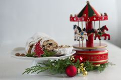 Christmas cake - Stollen, bauble and carousel music box Stock Photography