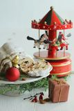 Christmas cake - Stollen, bauble and carousel music box Royalty Free Stock Image