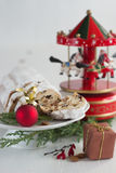 Christmas cake - Stollen, bauble and carousel music box Royalty Free Stock Images