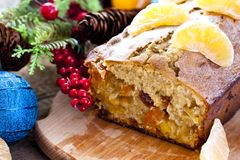 Christmas cake with tangerine and dried fruits. Christmas cake with tangerine, dried fruits and brandy Stock Images