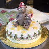 Christmas cake topped with Teddy in Santa hat Royalty Free Stock Photo