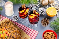 Christmas cake, two glasses of hot mulled wine with sliced orange. Christmas background with food and decorations. Top view stock photos