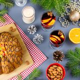 Christmas cake, two glasses of hot mulled wine with sliced orange. Christmas background with food and decorations. Top view royalty free stock photo