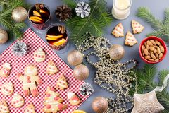 Christmas cake, two glasses of hot mulled wine with sliced orange. Christmas background with food and decorations stock images