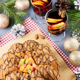 Christmas cake, two glasses of hot mulled wine with sliced orange. Christmas background with food and decorations stock photos