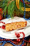 Christmas cake on white plate with fur tree and christmas toys. Vertical Stock Image