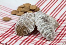 Christmas cakes. Christmas sweet cakes and apricot seeds on tablecloth Royalty Free Stock Images