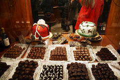 Christmas cakes. Chocolate cakes and sweets in a shop window of salerno in christmas time royalty free stock photos