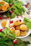 Christmas cakes. Fresh apricots and christmas decorations on the table. selective focus royalty free stock images