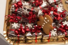 Christmas cakes. Gift with red ribbon stock images