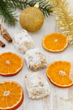 Christmas cakes and orange Royalty Free Stock Images