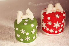 Christmas cakes. Red and green Christmas cakes stock images