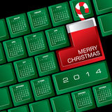 2014 Christmas calendar. Illustration of 2014 Christmas calendar on computer keyboard with candy cane Stock Photos