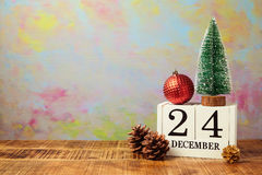Christmas calendar with pine tree on wooden table Royalty Free Stock Image