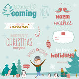 Christmas calligraphic wishes and winter elements Royalty Free Stock Images