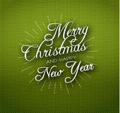 Christmas calligraphy on knitted pattern Stock Photo