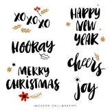 Christmas calligraphy phrases. Hand drawn design elements.