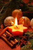 Christmas candĺe. Christmas decorations, candle and needles Stock Photos